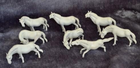 Eight white fine porcelain horses